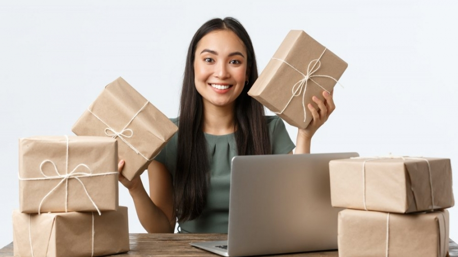Small business owners, startup and e-commerce concept. Smiling asian woman get lots of orders
