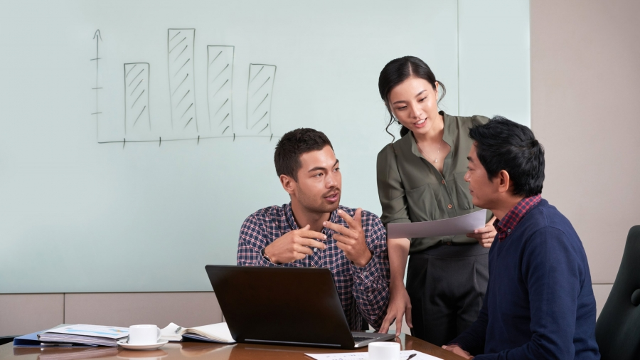 Group of young coworkers discussing project together